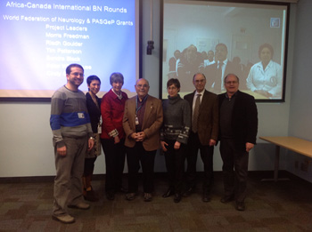 In front of screen in Canada (left to right) Ayman Selim, Carmela Tartaglia, Sandra Black, Arnold Noyek, Cindy Grief, Morris Freedman, Tim  Patterson. On the screen from Tunisia (foreground, left to right) Riadh Gouider, Mouna Ben Djebara and (background) Tunisian participants.