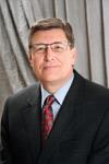 John D. England, MD