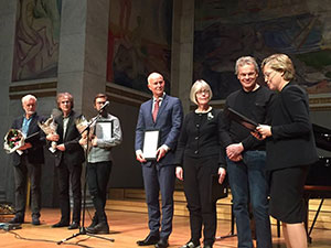 From left to right: Brain musicians Kristoffer Lo, John Pà¥l Inderberg and Henning Sommerro; Director of the National Health Directorate Bjørn Guldvog; State Secretary Anne Grethe Erlandsen from the Ministry of Health and Care Service and the Nobel Laureate Edvard Moser together with Hanne Harbo from the Norwegian Brain Council. (Photo courtesy: Norwegian Brain Council.)