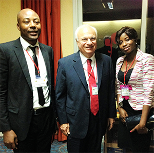 Neurologist Yannick Fogang Fogoum, MD, Cameroon (left), and Prisca-Rolande Bassolé, MD, Burkina Faso (right), meet with WFN President Raad Shakir, MD, to discuss the African Academy of Neurology.