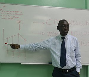 Dr. Gallo Diop makes a presentation for neurology residents.