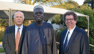 Dr. Mansour Ndiaye (center), head of neurology, meets with Drs. Wolfgang Grisold (left) and Steven L. Lewis.