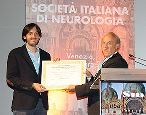 "The Past President of Italian Neurological Society, Prof. Quattrone (right) presents an award to Dr. Luca Bello for his paper ""DMD Genotypes and Loss of Ambulation in the CIRNG Duchenne Natural History Study,"" published in Neurology."